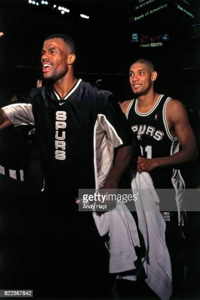 David Robinson and Tim Duncan of the San Antonio Spurs walk off the court after winning Game Five of the 1999 NBA Finals at Madison Square Garden on...