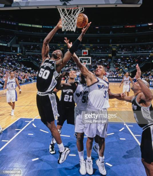 David Robinson, Center for the San Antonio Spurs and Gerard King, Small Forward for the Washington Wizards challenge for the ball during their NBA...