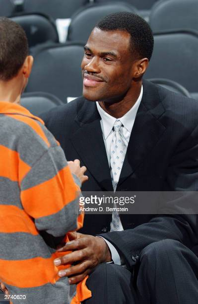 David Robinson formerly of the San Antonio Spurs talks with a fan before his jersey retirment ceremony at the SBC Center on November 10 2003 in San...