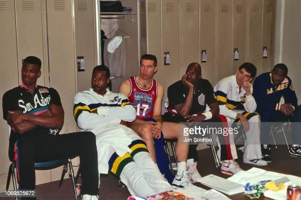 David Robinson Karl Malone Chris Mullin Terry Porter John Stockton Tim Hardaway of the Western Conference AllStars in the locker room against the...