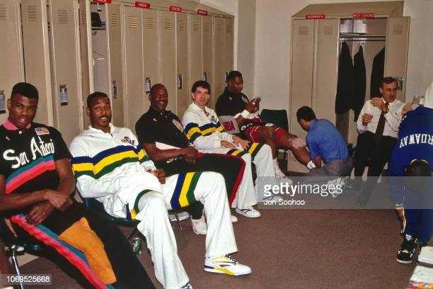 David Robinson Karl Malone Terry Porter and John Stockton of the Western Conference AllStars smiles for a photo in the locker room against the...