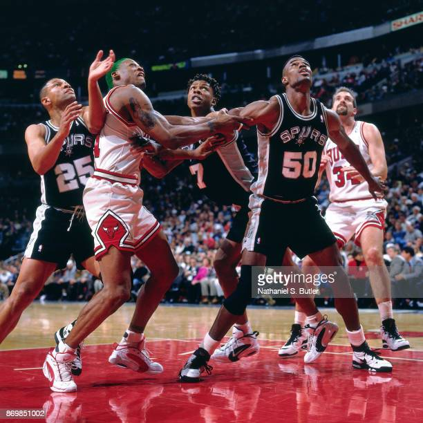 David Robinson of the San Antonio Spurs and Dennis Rodman of the Chicago Bulls battle for position on December 8 1995 at the United Center in Chicago...