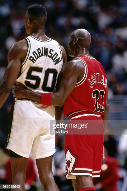 David Robinson of the San Antonio Spurs and Michael Jordan of the Chicago Bulls during the game on November 22 1995 at the Alamodome in San Antonio...