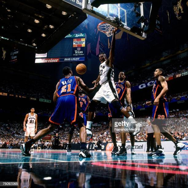 David Robinson of the San Antonio Spurs attempts a dunk against Charlie Ward of the New York Knicks in Game Two of the 1999 NBA Finals played at the...