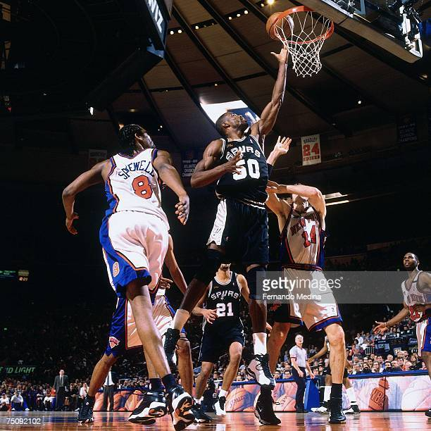 David Robinson of the San Antonio Spurs attempts a layup against Latrell Sprewell of the New York Knicks in Game Five of the 1999 NBA Finals at...