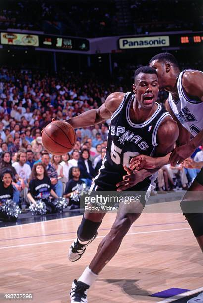 David Robinson of the San Antonio Spurs dribbles against the Sacramento Kings on April 6 1995 at Arco Arena in Sacramento California NOTE TO USER...