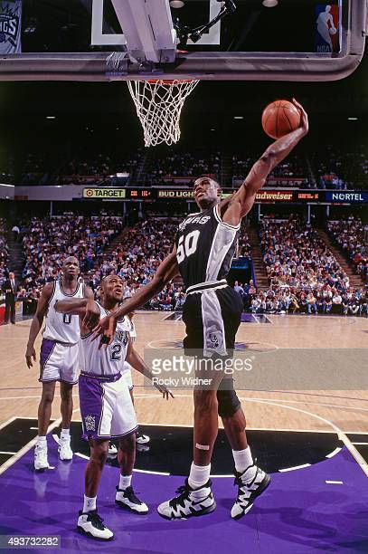 David Robinson of the San Antonio Spurs dunks against the Sacramento Kings on April 6 1995 at Arco Arena in Sacramento California NOTE TO USER User...