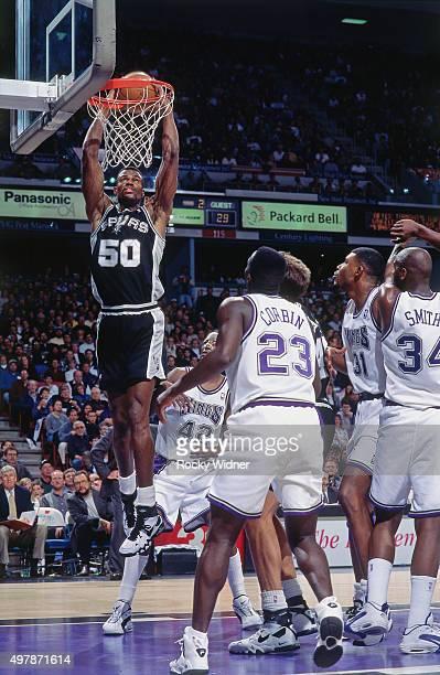 David Robinson of the San Antonio Spurs dunks against the Sacramento Kings circa 1996 at Arco Arena in Sacramento California NOTE TO USER User...