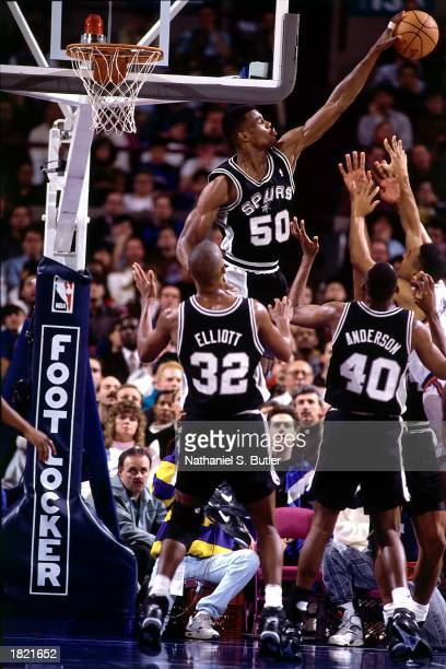 David Robinson of the San Antonio Spurs goes up high to block a shot against the New York Knicks at Madison Square Garden during the 1991 season in...