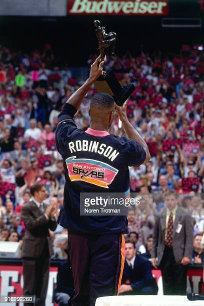 David Robinson of the San Antonio Spurs is presented the MVP Trophy during Game Two of the Conference Finals of the 1995 NBA Playoffs played on May...
