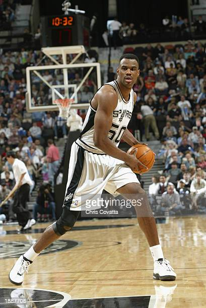 David Robinson of the San Antonio Spurs looks to pass during the NBA game against the Los Angeles Lakers at SBC Center on March 23 2003 in San...