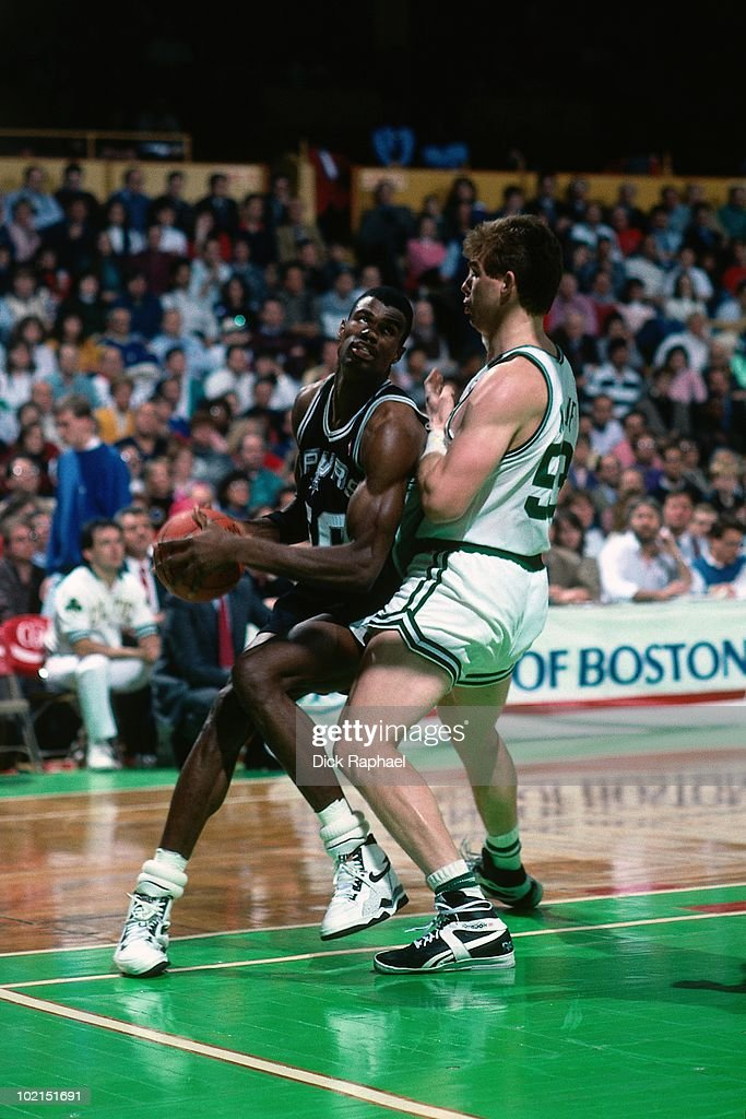 David Robinson #50 of the San Antonio Spurs makes a move to the basket against Joe Kleine #53 of the Boston Celtics during a game played in 1990 at the Boston Garden in Boston, Massachusetts.