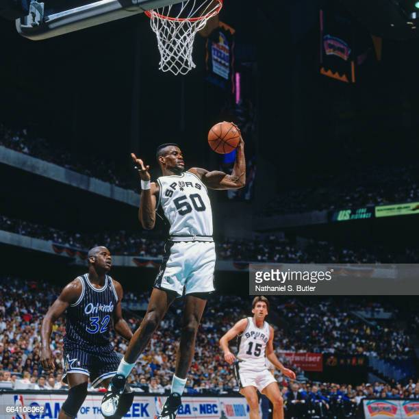 David Robinson of the San Antonio Spurs rebounds against the Orlando Magic during a game played circa 1994 at the Alamo Dome in San Antonio Texas...