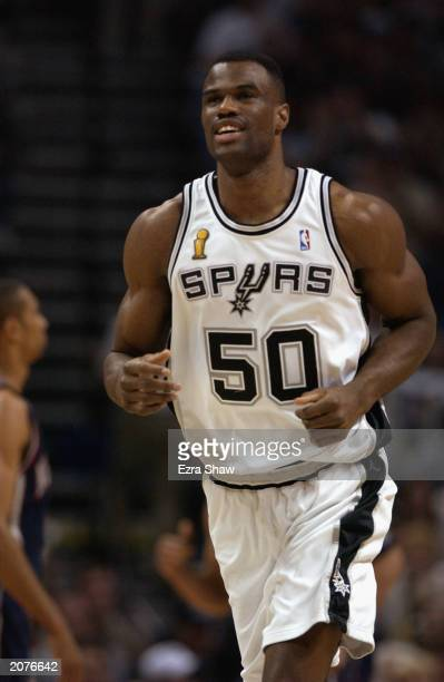 David Robinson of the San Antonio Spurs runs during Game two of the 2003 NBA Finals against the New Jersey Nets at SBC Center on June 6 2003 in San...