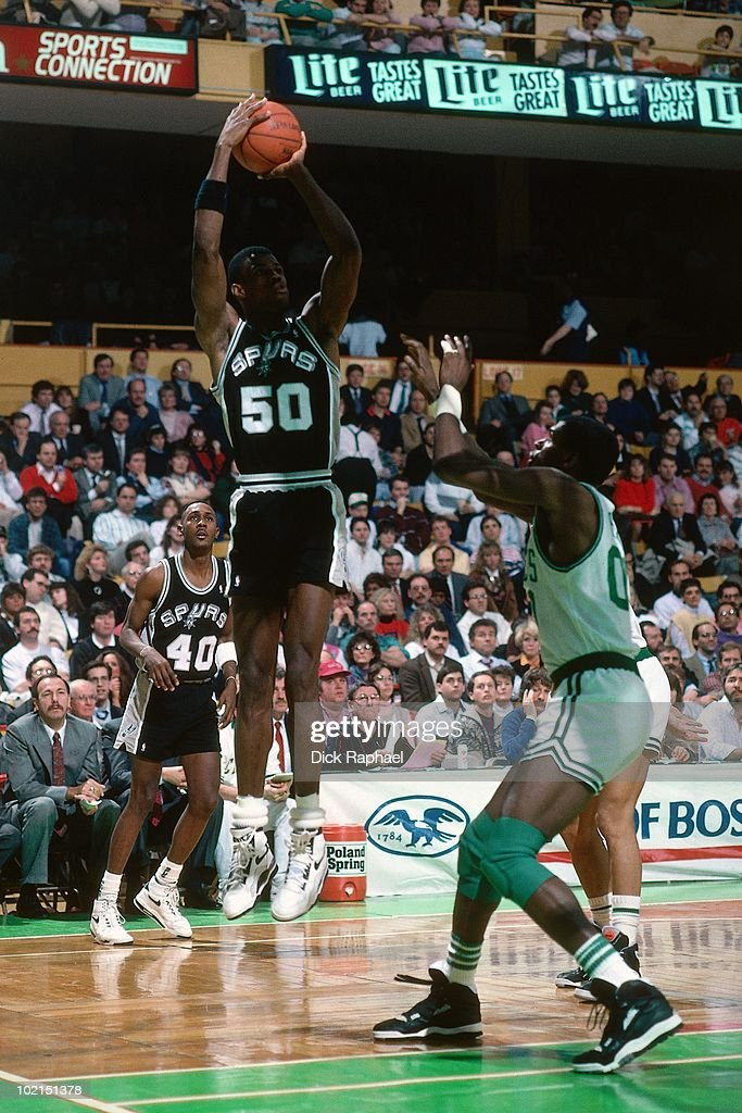 David Robinson #50 of the San Antonio Spurs shoots a jump shot against the Boston Celtics during a game played in 1990 at the Boston Garden in Boston, Massachusetts.