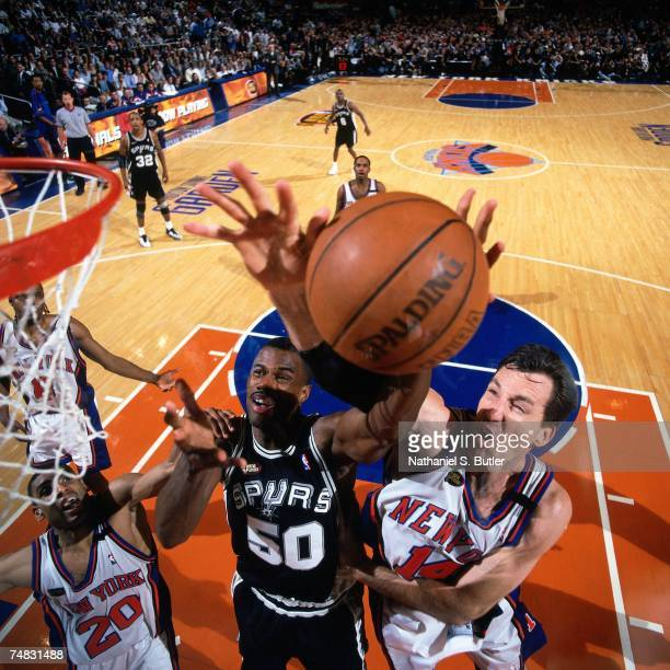 David Robinson of the San Antonio Spurs shoots against Chris Dudley of the New York Knicks during Game Five of the 1999 NBA Finals at Madison Square...
