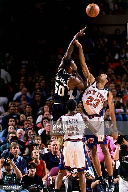 David Robinson of the San Antonio Spurs shoots against Marcus Camby of the New York Knicks in Game 5 to win the 1999 NBA Championship on June 25 1999...