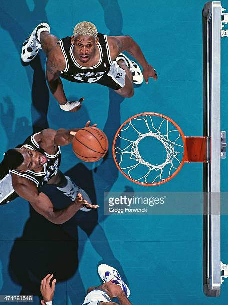 David Robinson of the San Antonio Spurs shoots against the Charlotte Hornets on December 1 1993 at Charlotte Coliseum in Charlotte NC NOTE TO USER...