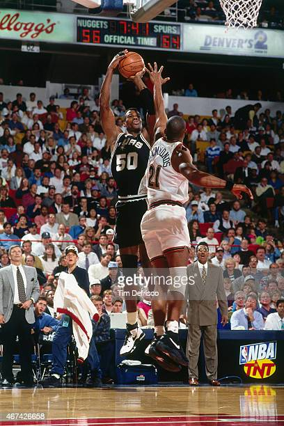 David Robinson of the San Antonio Spurs shoots against Tom Hammonds of the Denver Nuggets in the Quarterfinals Game Three of the Playoffs on May 2...