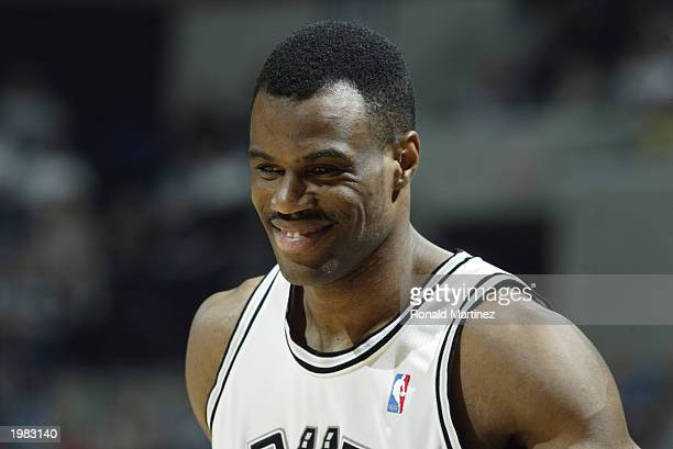 David Robinson of the San Antonio Spurs smiles on the court in Game five of the Western Conference Quarterfinals against the Phoenix Suns during the...