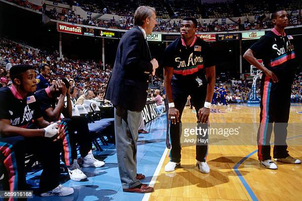 David Robinson of the San Antonio Spurs stands on the court during a game circa 1993 at the Alamodome in San Antonio Texas NOTE TO USER User...