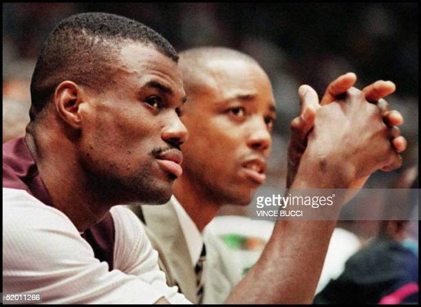 David Robinson of the San Antonio Spurs watches from the bench as his team looses to the Los Angeles Lakers 9686 during their 22 November game in Los...