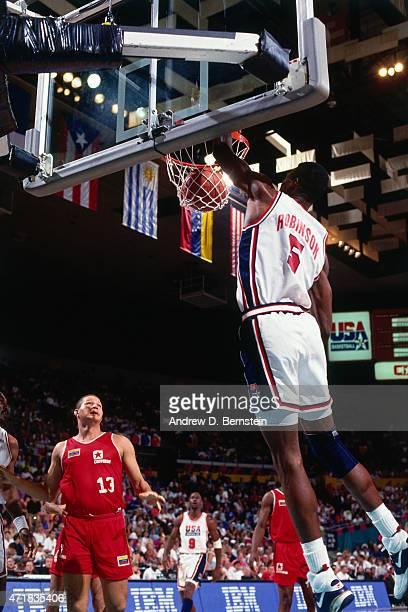David Robinson of the United States dunks against Venezuela circa 1992 in the 1992 Summer Olympics at Palau Municipal d'Esports de Badalona in...