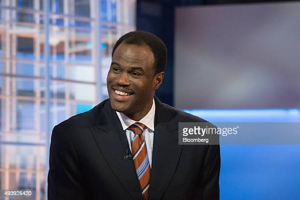 David Robinson San Antonio Spurs minority owner and cofounder at Admiral Capital Group smiles during a Bloomberg Television interview in New York US...