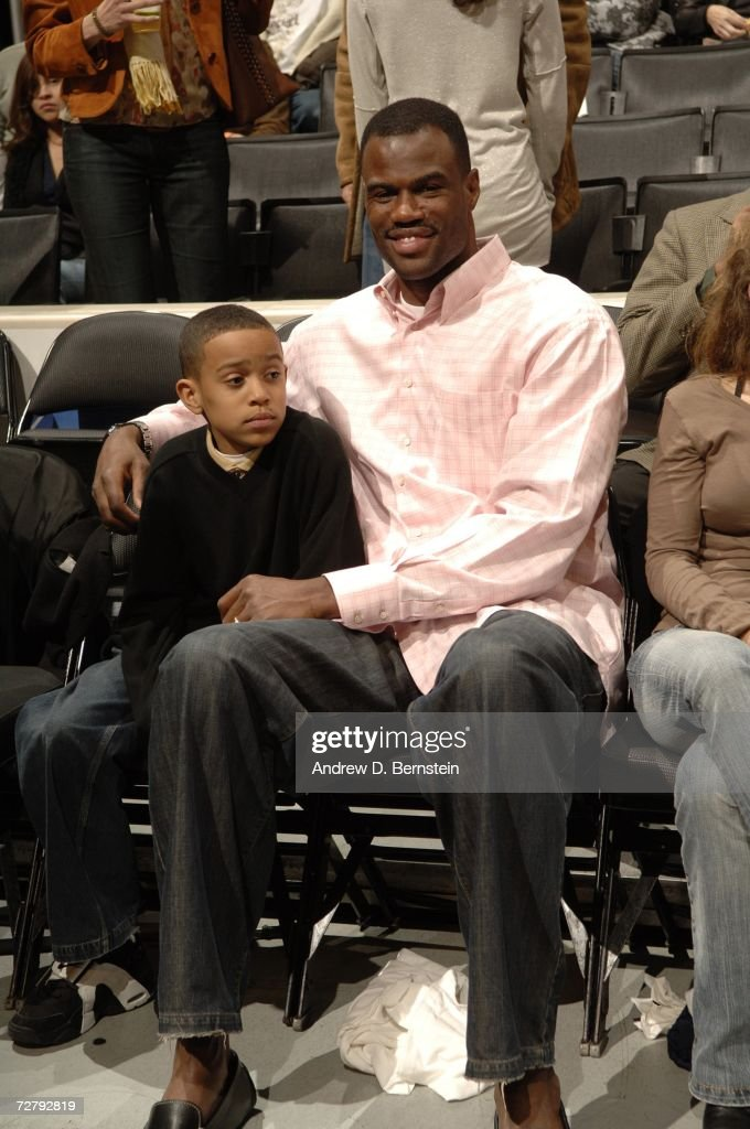 David Robinson sits courtside with his son as the Los Angeles Lakers play against the San Antonio Spurs at Staples Center December 10, 2006 in Los Angeles, California.