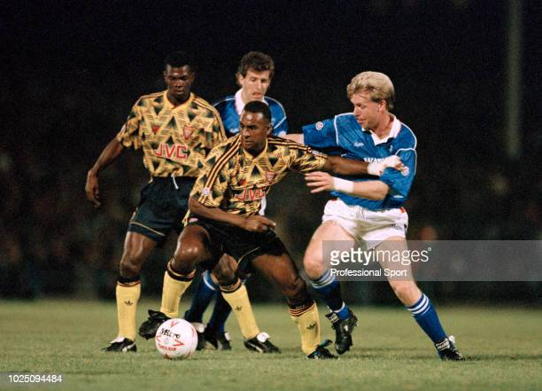 David Rocastle of Arsenal is challenged by David Oldfield of Leicester City watched by Paul Davis and Colin Gibson during the Rumbelows Cup match...