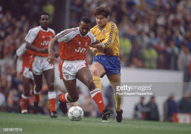 David Rocastle of Arsenal is challenged by Paul Bracewell of Sunderland during a Barclays League Division One match at Highbury on October 27 1990 in...