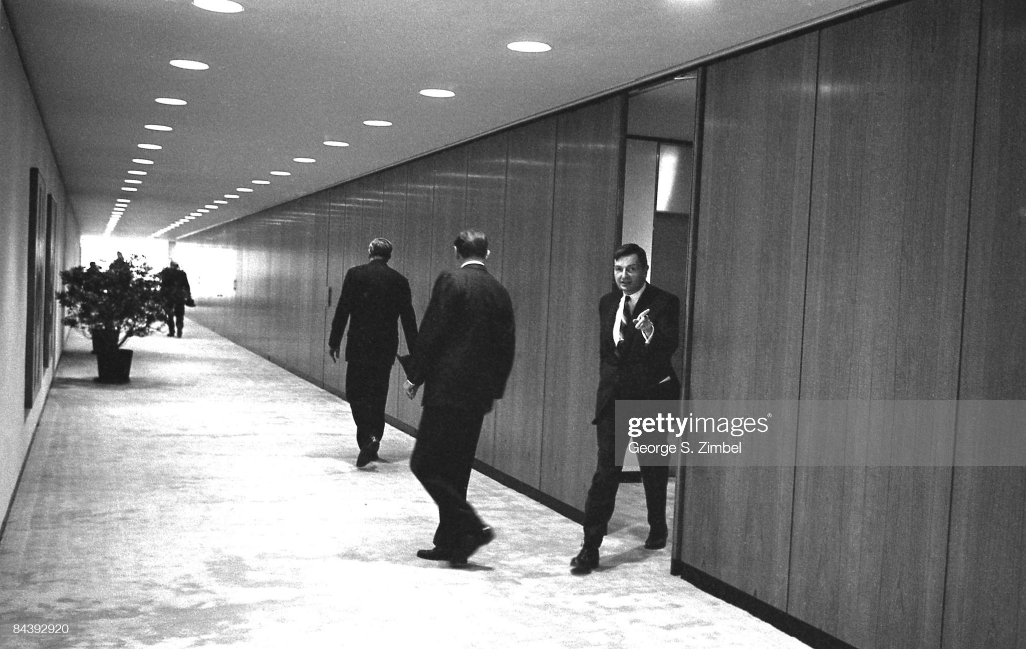 https://media.gettyimages.com/photos/david-rockefeller-sr-walks-out-into-the-hallways-of-the-chase-1960s-picture-id84392920?s=2048x2048