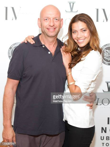 David Rosenberg and model Tina Marie Clark pose together at Love Universe's presentation of the Art For Life Reception hosted by Russell Simmons...