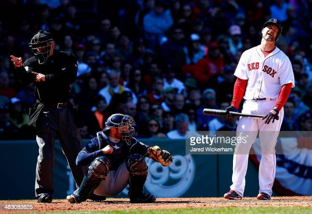 David Ross of the Boston Red Sox argues a called strike in the second inning against the Milwaukee Brewers during the game at Fenway Park on April 6...