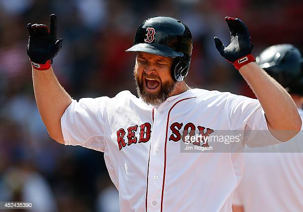 David Ross of the Boston Red Sox reacts after hitting a threerun home run against the Kansas City Royals in the fourth inning at Fenway Park on July...