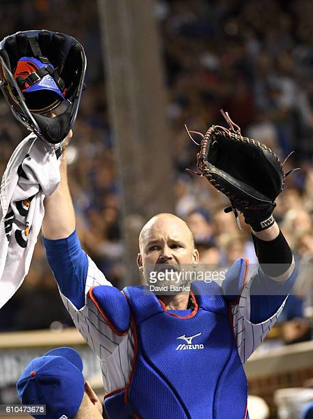 David Ross of the Chicago Cubs acknowledges the crowd after being taken out of the game during the seventh inning of a game against the St Louis...
