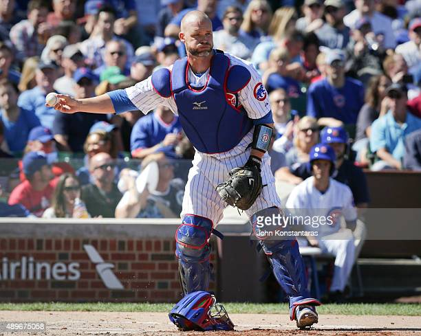 David Ross of the Chicago Cubs hands the ball to the umpire during the second inning against the St Louis Cardinals at Wrigley Field on September 20...