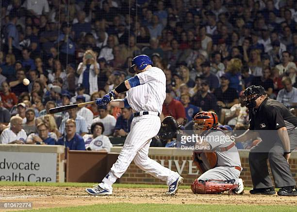 David Ross of the Chicago Cubs hits a home run against the St Louis Cardinals during the fifth inning on September 25 2016 at Wrigley Field in...