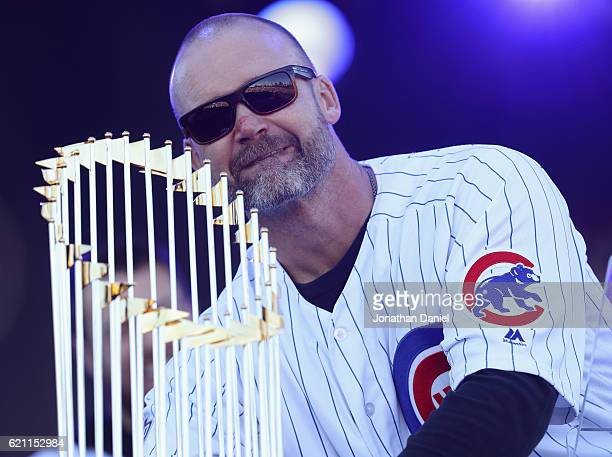 David Ross of the Chicago Cubs holds the World Series trophy during the Chicago Cubs victory celebration in Grant Park on November 4 2016 in Chicago...
