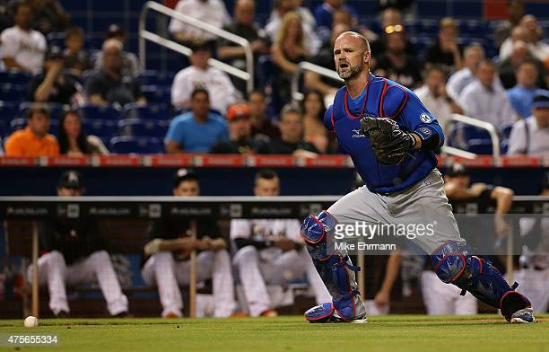 David Ross of the Chicago Cubs misplays a ground ball during a game against the Miami Marlins at Marlins Park on June 2 2015 in Miami Florida