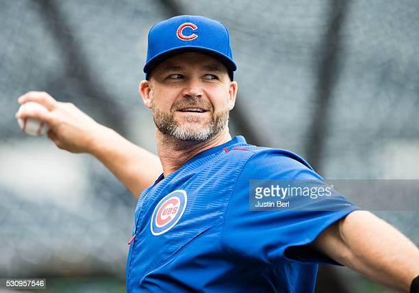 David Ross of the Chicago Cubs plays catch during batting practice before the game against the Pittsburgh Pirates at PNC Park on May 2 2016 in...