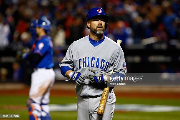 David Ross of the Chicago Cubs reacts after being stuck out in the third inning against Matt Harvey of the New York Mets during game one of the 2015...