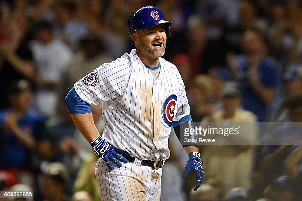 David Ross of the Chicago Cubs reacts after scoring a run in the second inning of a game against the Cincinnati Reds at Wrigley Field on September 20...
