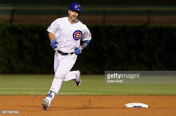 David Ross of the Chicago Cubs rounds the bases after hitting a home run in the sixth inning against the Pittsburgh Pirates at Wrigley Field on June...