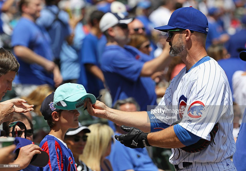 David Ross #3 of the Chicago Cubs signs autographs before a game against the Los Angeles Dodgers at Wrigley Field on June 2, 2016 in Chicago, Illinois. The Cubs defeated the Dodgers 7-2.