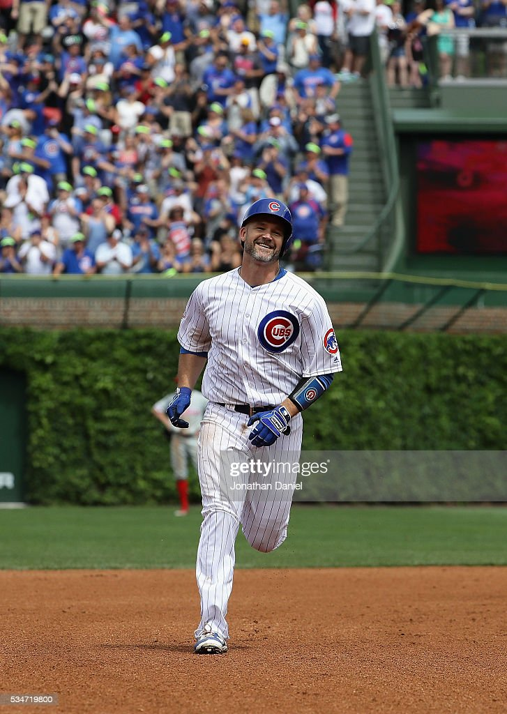 David Ross #3 of the Chicago Cubs smiles as he runs the bases after hitting the 100th home run of his career in 4th inning against the Philadelphia Phillies at Wrigley Field on May 27, 2016 in Chicago, Illinois.