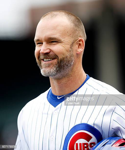 David Ross of the Chicago Cubs smiles while warming up before the game against the Atlanta Braves at Wrigley Field on April 29 2016 in Chicago...