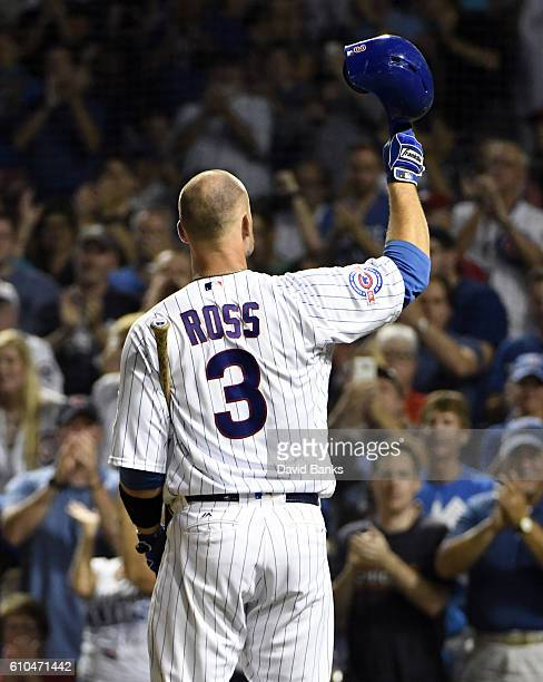 David Ross of the Chicago Cubs tips his helmet to the fans before he bats against the St Louis Cardinals during the second inning on September 25...