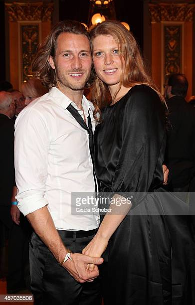 David Rott and his wife Elena attend the Hessian Film And Cinema Award 2014 on October 10 2014 at Alte Oper in Frankfurt am Main Germany