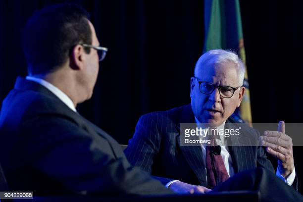 David Rubenstein cochief executive officer of Carlyle Group LP speaks as Steven Mnuchin US Treasury secretary left listens during an Economic Club of...